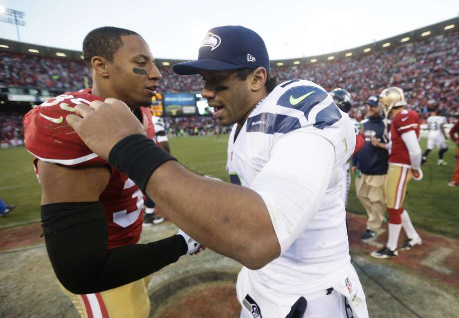 San Francisco 49ers free safety Eric Reid, left, greets Seattle Seahawks quarterback Russell Wilson, right, at the end of an NFL football game, Sunday, Dec. 8, 2013, in San Francisco. The 49ers beat the Seahawks 19-17. (AP Photo/Marcio Jose Sanchez) Photo: Marcio Jose Sanchez, AP
