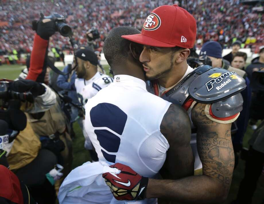 Seattle Seahawks wide receiver Ricardo Lockette, left, is embraced by San Francisco 49ers quarterback Colin Kaepernick, right, at the end of their NFL football game, Sunday, Dec. 8, 2013, in San Francisco. The 49ers beat the Seahawks 19-17. (AP Photo/Marcio Jose Sanchez) Photo: Marcio Jose Sanchez, AP