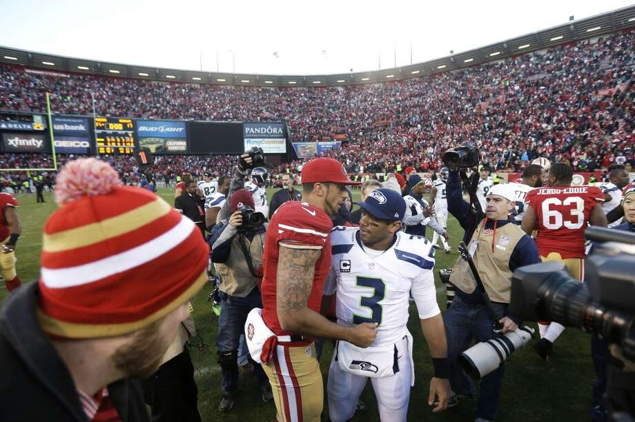 San Francisco 49ers quarterback Colin Kaepernick, left, talks with Seattle Seahawks quarterback Russell Wilson (3) after an NFL football game at Candlestick Park, Sunday, Dec. 8, 2013, in San Francisco. The 49ers beat the Seahawks 19-17. (AP Photo/Marcio Jose Sanchez) Photo: Marcio Jose Sanchez, AP