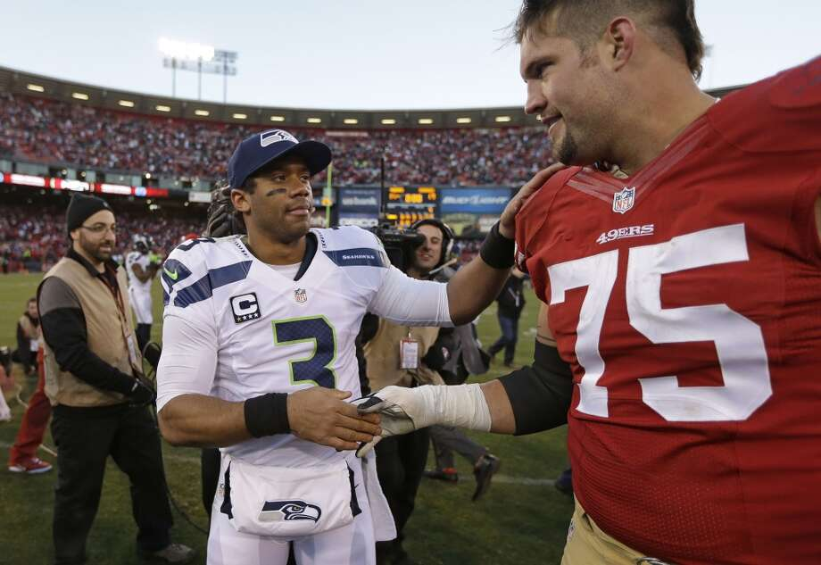 Seattle Seahawks quarterback Russell Wilson, left, shakes hands with San Francisco 49ers guard Alex Boone, right, at the end of an NFL football game, Sunday, Dec. 8, 2013, in San Francisco. The 49ers defeated the Seahawks 19-17. (AP Photo/Ben Margot) Photo: Ben Margot, AP