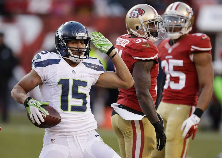 Seattle Seahawks wide receiver Jermaine Kearse, left, celebrates after making a first down as San Francisco 49ers strong safety Donte Whitner (31) and free safety Eric Reid (35) look on in the second half of an NFL football game, Sunday, Dec. 8, 2013, in San Francisco. (AP Photo/Ben Margot) Photo: Ben Margot, AP