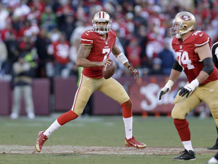 San Francisco 49ers quarterback Colin Kaepernick looks to throw in the second half of an NFL football game against the Seattle Seahawks, Sunday, Dec. 8, 2013, in San Francisco. At right is San Francisco 49ers tackle Joe Staley. (AP Photo/Marcio Jose Sanchez) Photo: Marcio Jose Sanchez, AP
