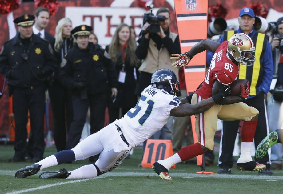 San Francisco 49ers tight end Vernon Davis (85) is tackled by Seattle Seahawks outside linebacker Bruce Irvin (51) after a reception in the first half of an NFL football game, Sunday, Dec. 8, 2013, in San Francisco. (AP Photo/Ben Margot) Photo: Ben Margot, ASSOCIATED PRESS