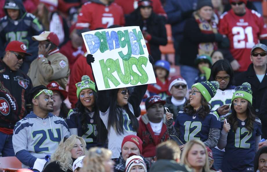 Seattle Seahawks fans cheer at Candlestick Park in the first half of an NFL football game against the San Francisco 49ers, Sunday, Dec. 8, 2013, in San Francisco. (AP Photo/Ben Margot) Photo: Ben Margot, AP