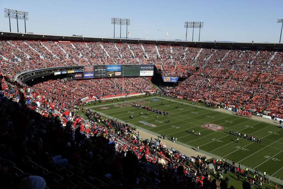Fans at Candlestick Park watch pre game ceremonies before the start of an NFL football game between the San Francisco 49ers and the Seattle Seahawks, Sunday, Dec. 8, 2013, in San Francisco. (AP Photo/Eric Risberg) Photo: Eric Risberg, AP