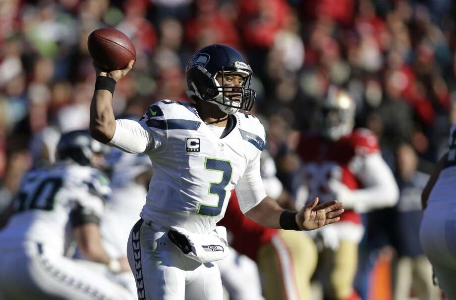 Seattle Seahawks quarterback Russell Wilson drops back to throw in the first half of an NFL football game against the San Francisco 49ers, Sunday, Dec. 8, 2013, in San Francisco. (AP Photo/Marcio Jose Sanchez) Photo: Marcio Jose Sanchez, AP