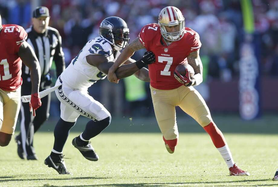 San Francisco 49ers quarterback Colin Kaepernick (7) is tackled by Seattle Seahawks defensive end Chris Clemons, left, in the first half of an NFL football game on Sunday, Dec. 8, 2013, in San Francisco. (AP Photo/Marcio Jose Sanchez) Photo: Marcio Jose Sanchez, ASSOCIATED PRESS