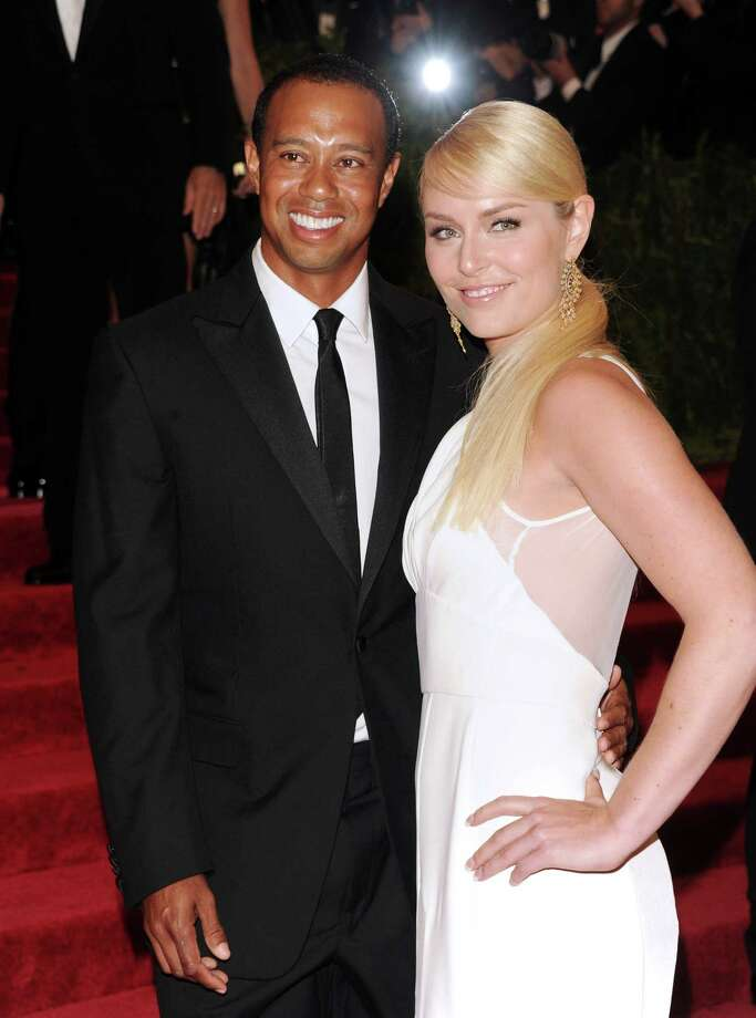 "FOR USE AS DESIRED, YEAR END PHOTOS - FILE - Golfer Tiger Woods and skier Lindsey Vonn attend The Metropolitan Museum of Art's Costume Institute benefit celebrating ""PUNK: Chaos to Couture"" on Monday May 6, 2013 in New York. (Photo by Evan Agostini/Invision/AP/File) ORG XMIT: NYYE231 Photo: Evan Agostini / Invision"