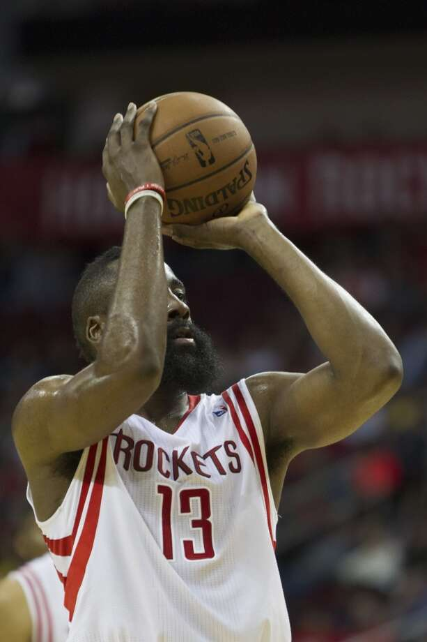Rockets shooting guard James Harden attempts a free throw against the Magic. Photo: Marie D. De Jesus, Houston Chronicle