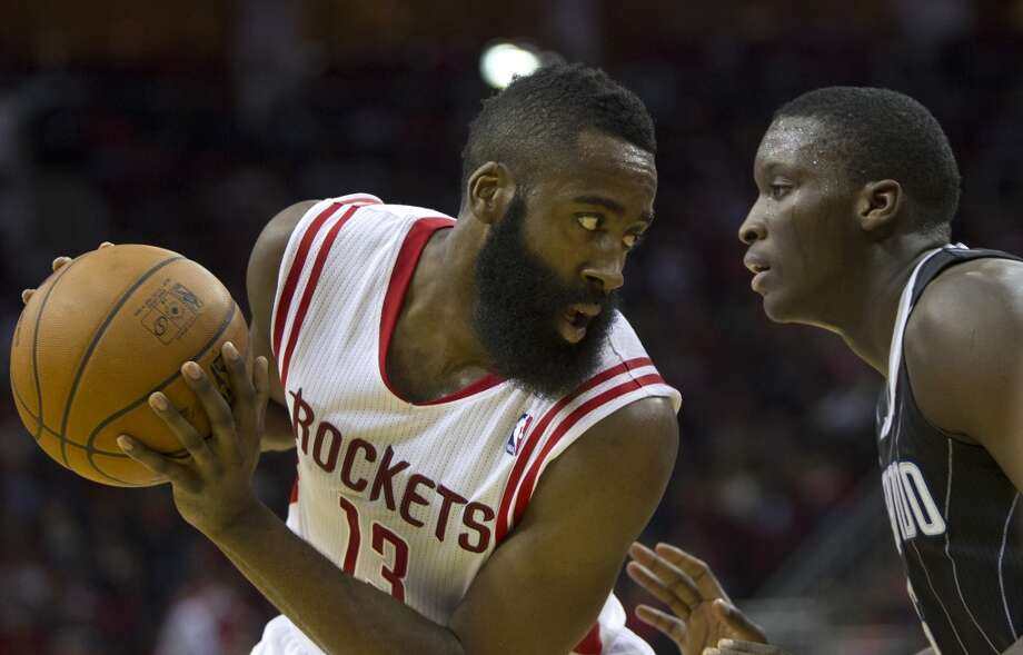 Rockets shooting guard James Harden sizes up Victor Oladipo of the Magic. Photo: Marie D. De Jesus, Houston Chronicle