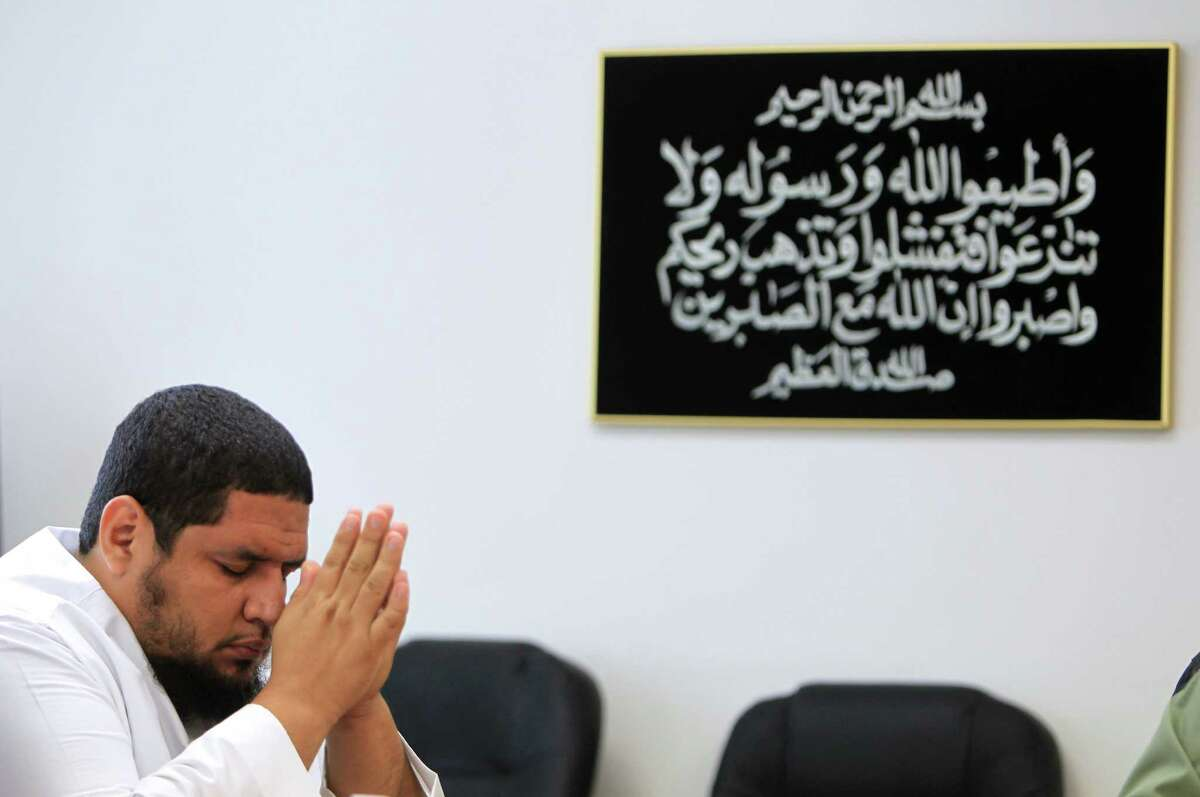 Isa Parada, of South Zone Islamic Center, 36, listens to fellow imams during a meeting at the Islamic Society of Greater Houston as they plan events toward youth empowerment.