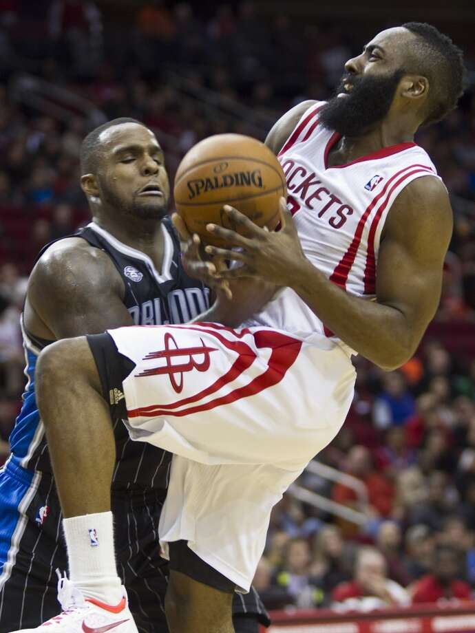 Glen Davis of the Magic tries to get a steal against Rockets shooting guard James Harden. Photo: Marie D. De Jesus, Houston Chronicle