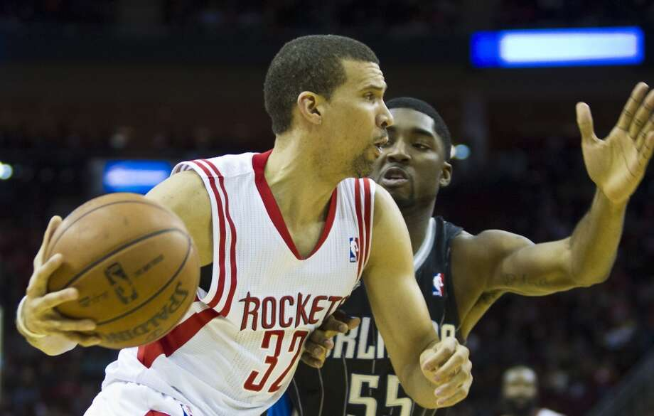 Francisco Garcia of the Rockets looks to make a play against the Magic. Photo: Marie D. De Jesus, Houston Chronicle