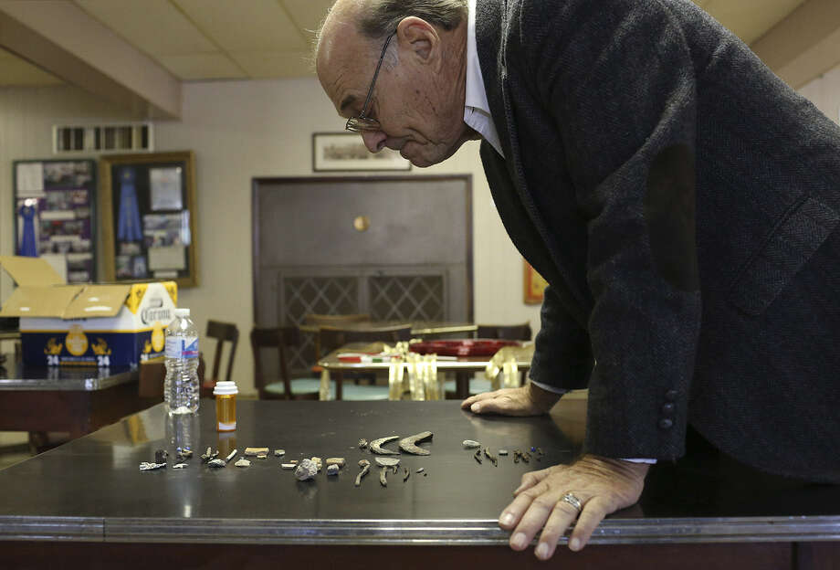 Frank Monaco looks at artifacts found on property owned by the Christopher Columbus Italian Society downtown, which might be remnants of the original 1718 Mission San Antonio Valero. Photo: Photos By Lisa Krantz / San Antonio Express-News