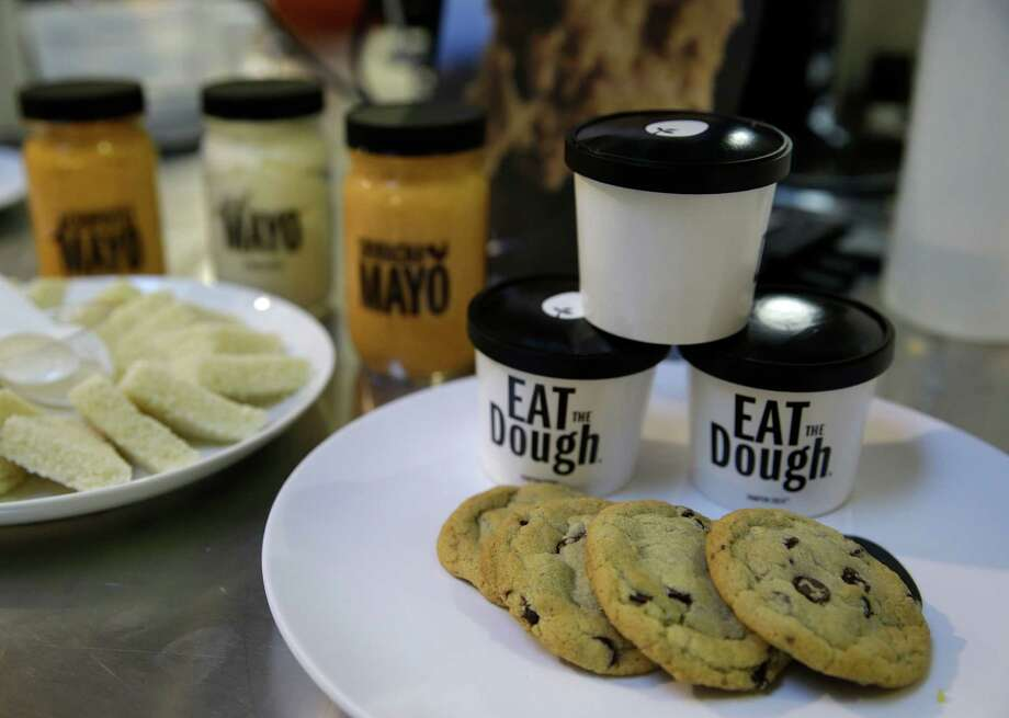 In this photo taken Tuesday, Dec. 3, 2013, plant-based products including chocolate chip cookies, cookie dough and mayonnaise are displayed at Hampton Creek Foods in San Francisco.  Can plants replace eggs? A San Francisco startup backed by Bill Gates believes they can. Hampton Creek Foods is scouring the planet for plants that can replace chicken eggs in everything from cookies to omelets to French toast. Funded by prominent Silicon Valley investors, the upstart seeks to disrupt a global egg industry that backers say wastes energy, pollutes the environment, causes disease outbreaks and confines chickens to tiny spaces. (AP Photo/Eric Risberg) ORG XMIT: CAER106 Photo: Eric Risberg / AP