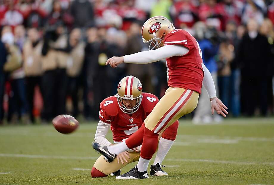 Phil Dawson kicks a 22-yard field goal with 26 seconds remaining to put the 49ers ahead 19-17. Photo: Thearon W. Henderson, Getty Images