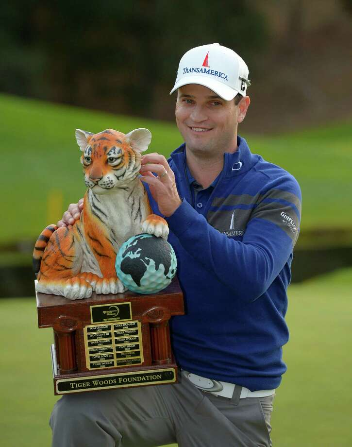Zach Johnson bagged a pair of tigers on Sunday, beating the human variety in a playoff and then taking home the more docile trophy kind for winning the World Challenge hosted by Tiger Woods. Photo: Mark J. Terrill, STF / AP