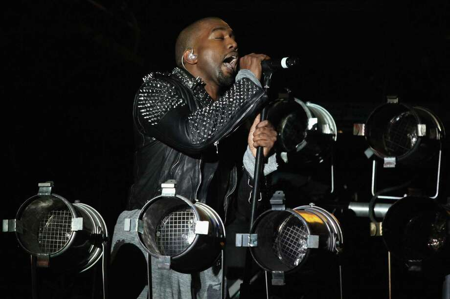 Kanye West, shown in an earlier concert in New York, performed at the AT&T Center on Sunday. It was the rapper's first concert in San Antonio. Photo: WireImage