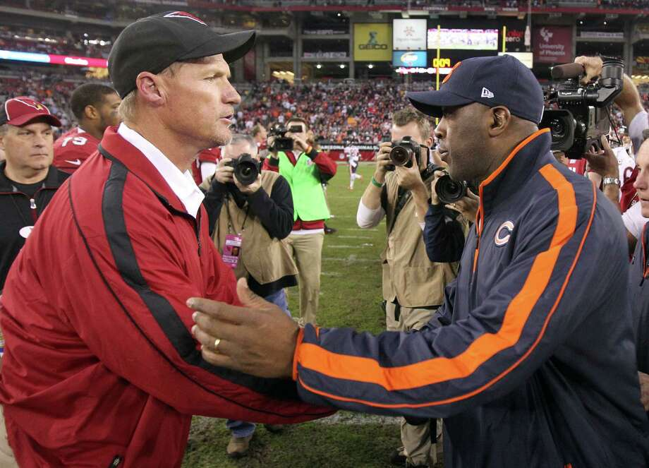 Ken Whisenhut, left, and Lovie Smith competed as coaches of the Cardinals and Bears, respectively, and now are potential candidates for the Texans job. Photo: Paul Connors, FRE / FR5880 AP