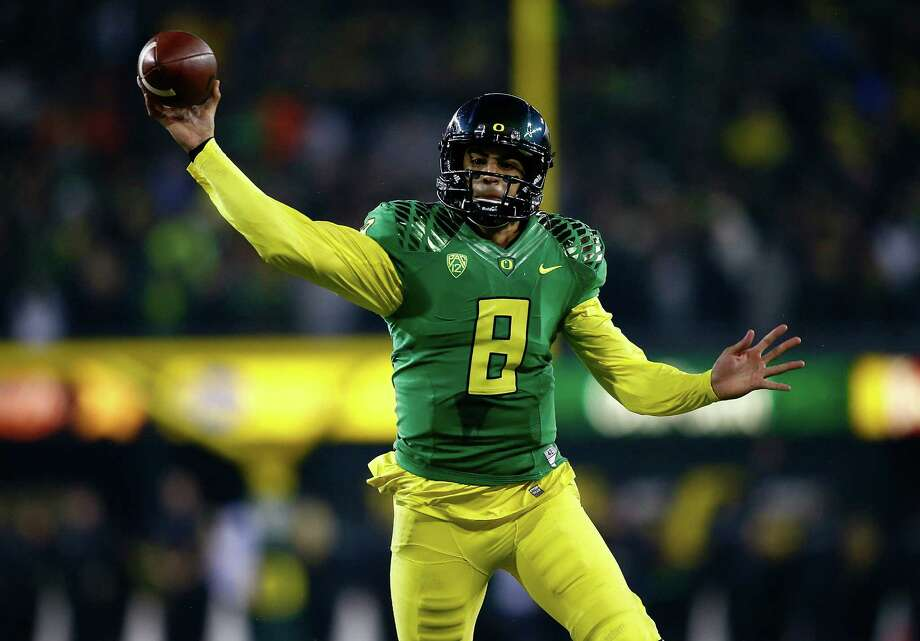 Oregon quarterback Marcus Mariota was a Heisman Trophy candidate until the Ducks lost two of their final four games. Photo: Jonathan Ferrey / Getty Images