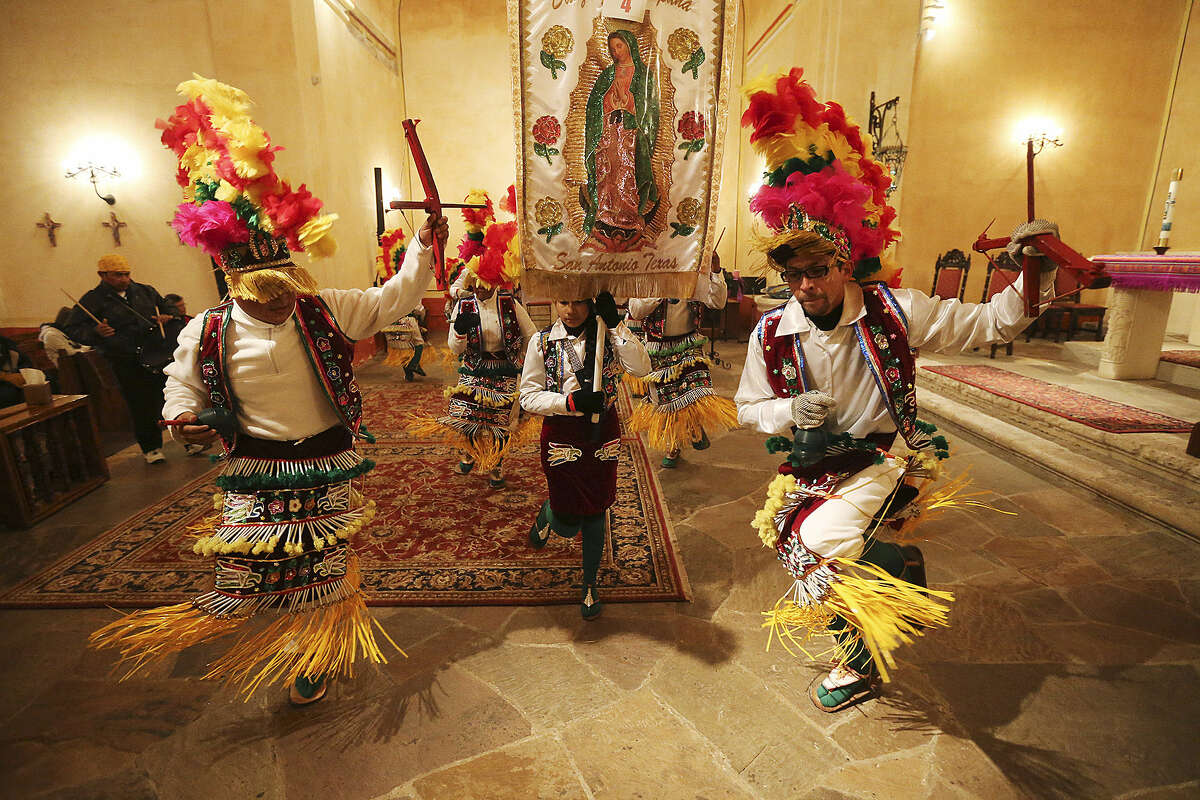 La Danza de Matachines brought close to 600 dancers to the Feast of Mission Concepción on Sunday. Dancers in colorful costumes came from area parishes, an intertribal Native American group and other cultural organizations to march from Concepción Park to the mission, where traditional dances were performed through the early morning. Father David Garcia led a bilingual Mass as part of the ceremony, which was held at the mission for the 282nd year. In this photo: Dancers from St. Bonaventure Church perform during La Danza de Matachines on Sunday at Mission Concepción