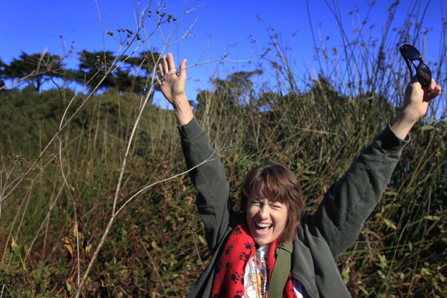Charlotte Monte tosses her hands in the as a sign of victory after finding a geocache near Lake Merced in San Francisco, Calif. in 2013 Photo: Mike Kepka , The Chronicle