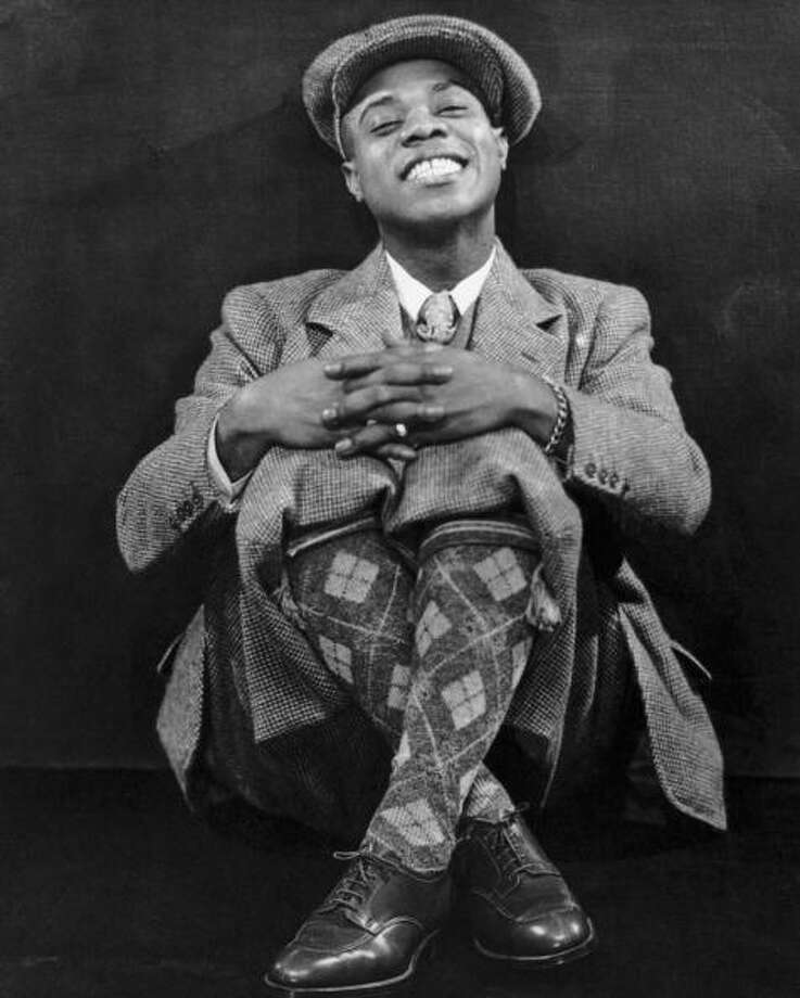 Louis Armstrong (dressed for his first European tour, in 1933).  Irrepressible musical genius. Photo: Frank Driggs Collection, Getty Images / 2007 Getty Images