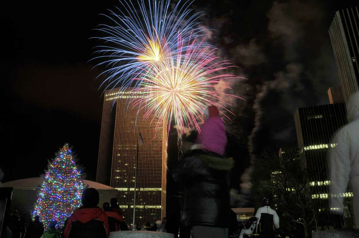 Fireworks explode in the sky during the tree lighting ceremony at the Empire State Plaza on Sunday, Dec. 8, 2013 in Albany, NY. (Paul Buckowski / Times Union)