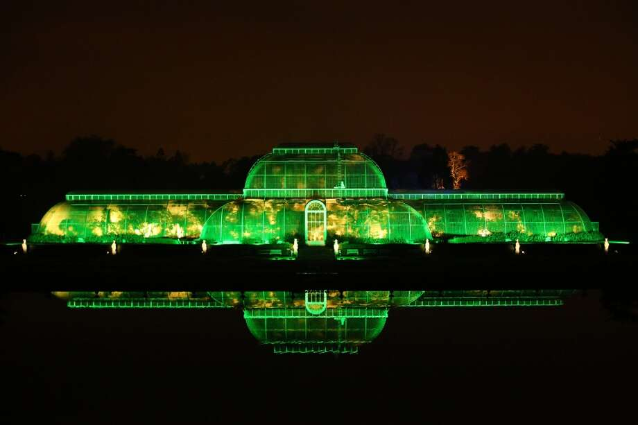 LONDON: The iconic Palm House is bathed in green light at the Royal Botanic Gardens, Kew. Photo: Peter Macdiarmid, Getty Images