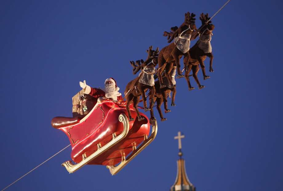 BERLIN: It's none other than Santa Claus waving from a sleigh suspended near the city's largest church, the Berliner Dom. Photo: Sean Gallup, Getty Images