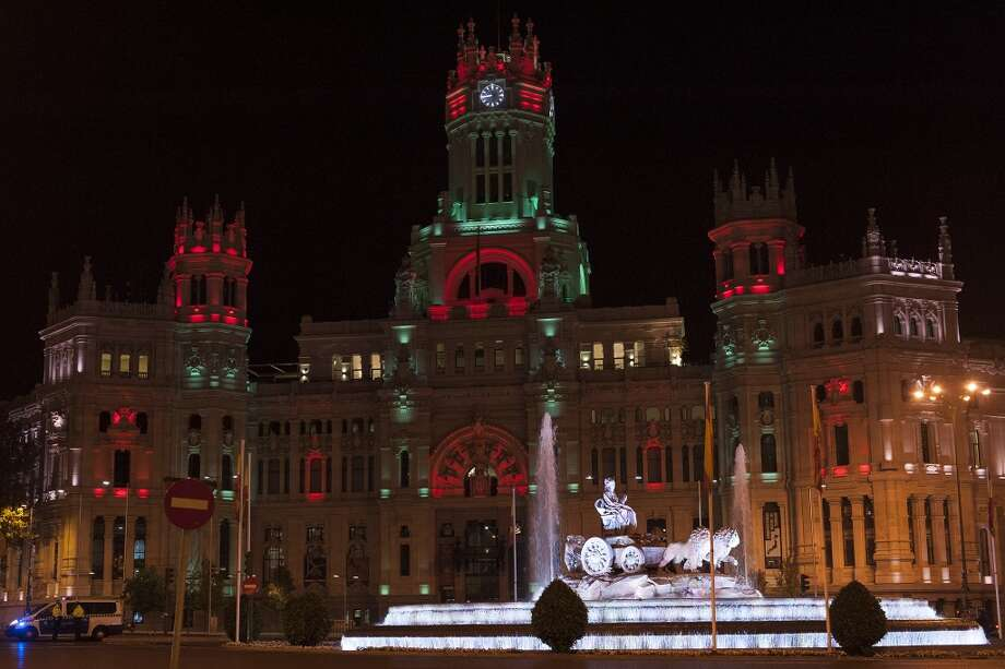 MADRID: Christmas lights illuminate Plaza de Cibeles and city hall. Each holiday season designers are commissioned by the city of Madrid to create the display. Photo: Gabriel Solera, Getty Images
