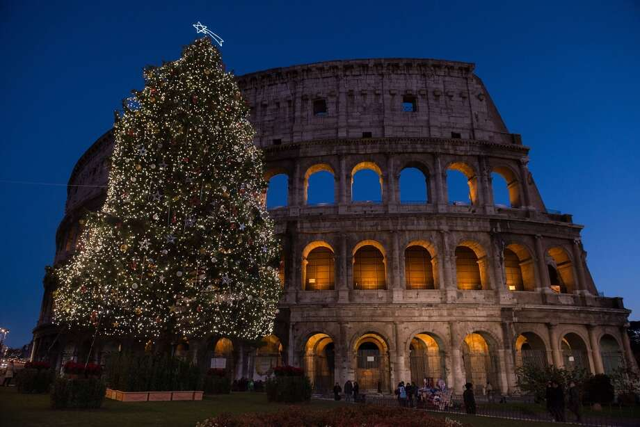 ROME:  Two icons – the Colosseum and a Christmas tree – glow against a dark blue sky. Photo: Giorgio Cosulich, Getty Images