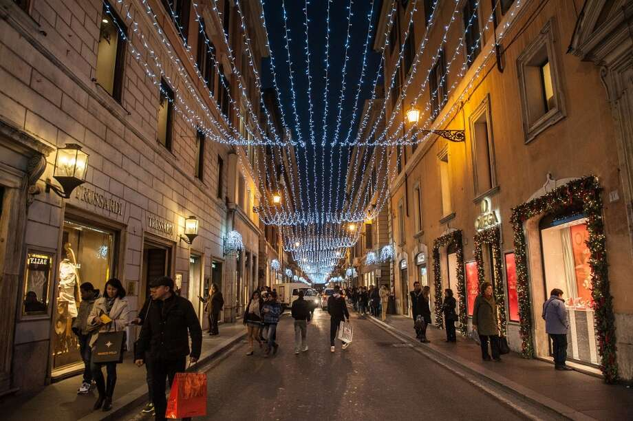 ROME:  Shoppers stroll under the Christmas lights hanging above the posh shopping street Via dei Condotti. Photo: Giorgio Cosulich, Getty Images