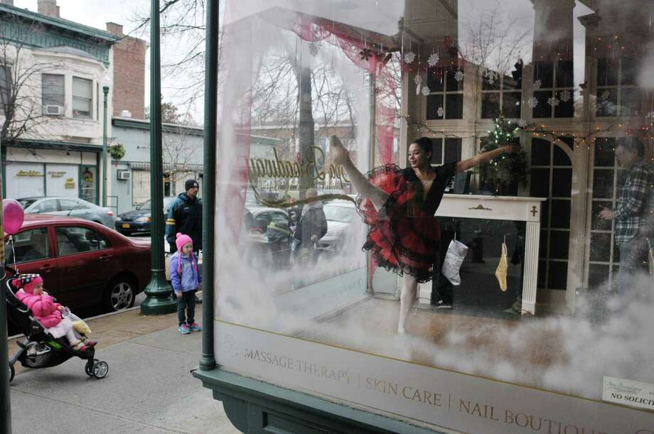 Albany Berkshire Ballet junior company dancer, Aniz Taylor performs a dance from the Nutcracker in the window of Spa Broadway at White Sands Massage during the Troy Victorian Stroll on Sunday, Dec. 8, 2013 in downtown Troy, NY.  Taylor will also perfrom in the company's full Nutcracker performance at the Egg on Dec. 21st.    (Paul Buckowski / Times Union) Photo: PAUL BUCKOWSKI / 00024702A
