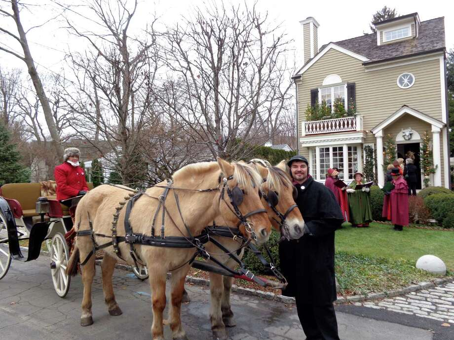 Hilda DelGaudio, in carriage, and Lee Griffin, with horses Billy and Bob), both of Allegra Farm in East Haddam, in front of author and interior designer Mar Jenningsí house during the annual Westport Historical Society house tour Sunday, this year labeled the Mar Jennings Classic New England Christmas House Tour. Photo: Mike Lauterborn, Meg Barone / Westport News contributed