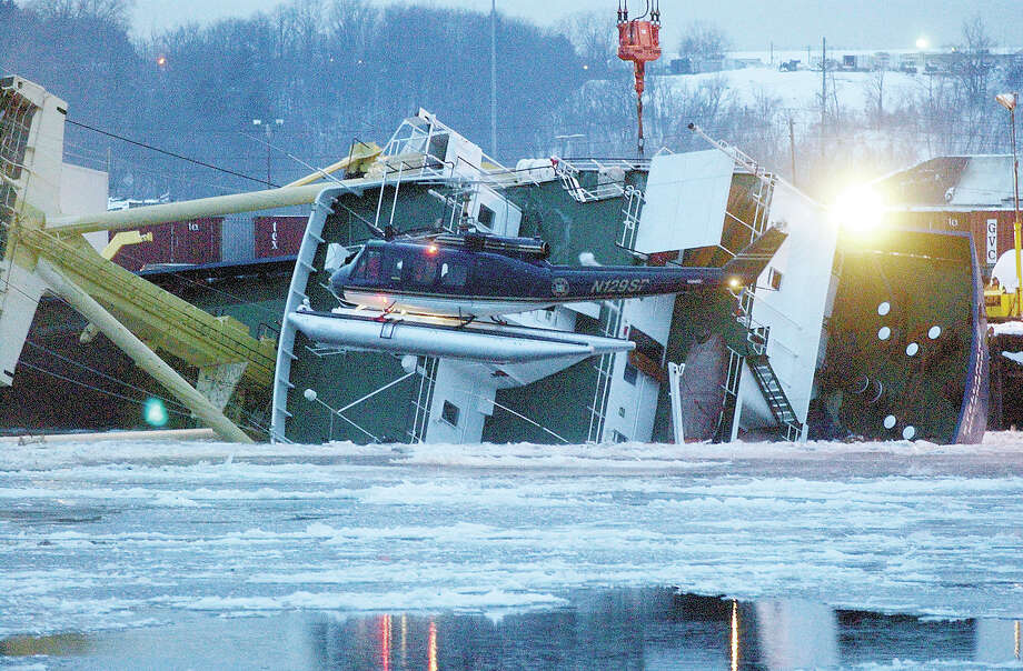 A New York State Police helicopter searches the icy Hudson River for crew members missing after the Dutch cargo ship Stellamare capsized while being loaded at the Port of Albany in Albany, N.Y., Tuesday, Dec. 9, 2003. The ship capsized while being loaded with General Electric turbines bound for Italy and Romania. (AP Photo/Troy Record, Tom Killips) ORG XMIT: MER2013120907265513 Photo: TOM KILLIPS / TROY RECORD