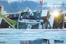 A New York State Police helicopter searches the icy Hudson River for crew members missing after the Dutch cargo ship Stellamare capsized while being loaded at the Port of Albany in Albany, N.Y., Tuesday, Dec. 9, 2003. The ship capsized while being loaded with General Electric turbines bound for Italy and Romania. (AP Photo/Troy Record, Tom Killips) ORG XMIT: MER2013120907265513