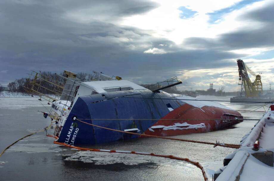 On Dec. 9, 2003, the cargo ship Stellamare capsized in the Port of Albany, killing three Russian sailors. Click through a slideshow of the work to try to rescue the men and right the ship.  Photo: PHILIP KAMRASS / ALBANY TIMES UNION