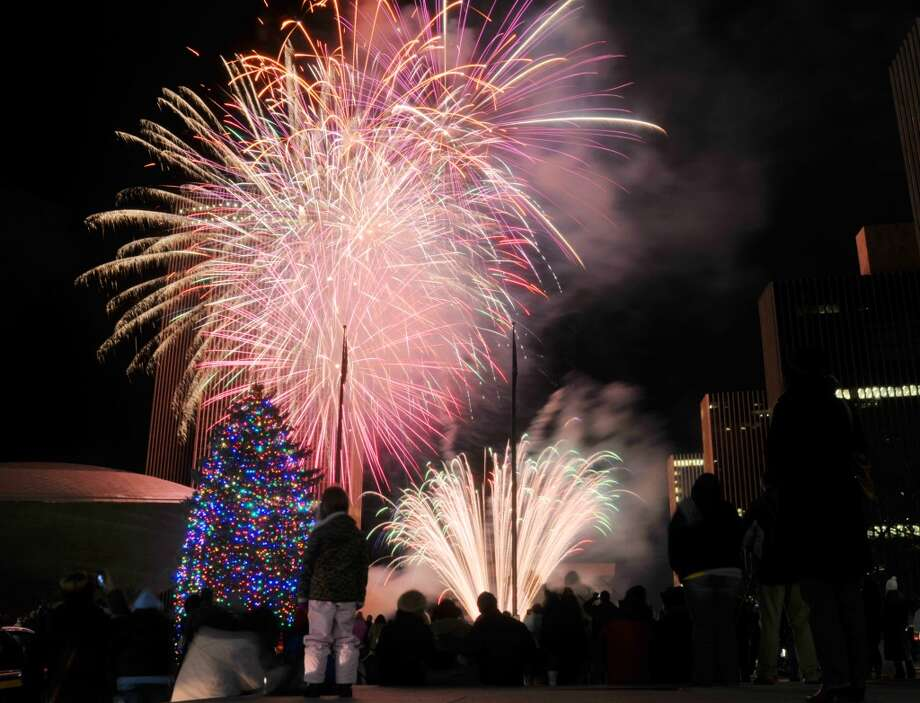 Fireworks explode in the sky during the tree lighting ceremony at the Empire State Plaza on Sunday, Dec. 8, 2013 in Albany, NY.    (Paul Buckowski / Times Union) Photo: ALBANY TIMES UNION