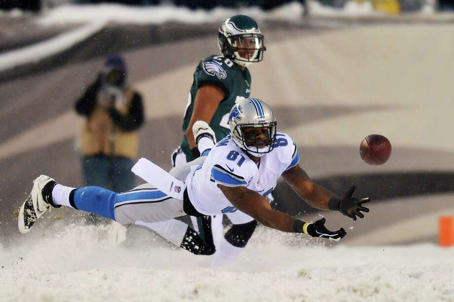 Calvin Johnson #81 of the Detroit Lions dives unsuccessfully for a pass in front of Cary Williams #26 of the Philadelphia Eagles at Lincoln Financial Field on December 8, 2013 in Philadelphia, Pennsylvania. The Eagles won 34-20. Photo: Drew Hallowell, Getty Images / 2013 Drew Hallowell