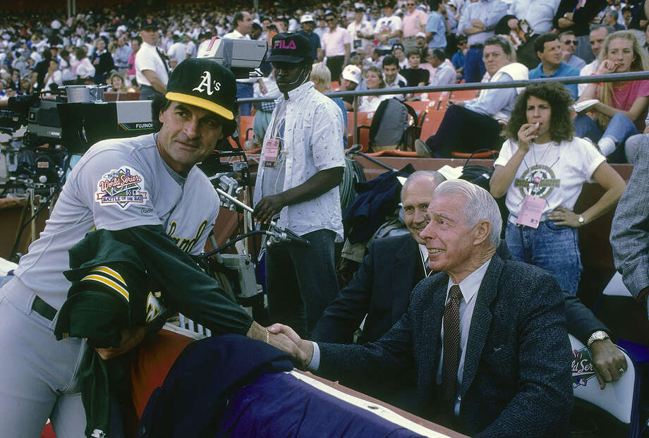Tony La Russa talks with Joe DiMaggio before Game 1 of the 1989 World Series. His Oakland A's swept the San Francisco Giants for the first of his three championships. Photo: Focus On Sport, File Photos / 2009 Focus on Sport