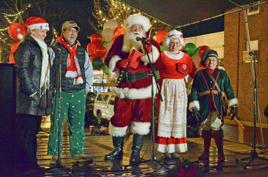Chamber of Commerce Executive Director Tucker Murphy and First Selectman Robert Mallozzi join Santa Claus, Mrs. Claus and Elf on the stage at the ninth annual Holiday Stroll in New Canaan on Friday, Dec. 6. Photo: Nelson Oliveira / New Canaan News