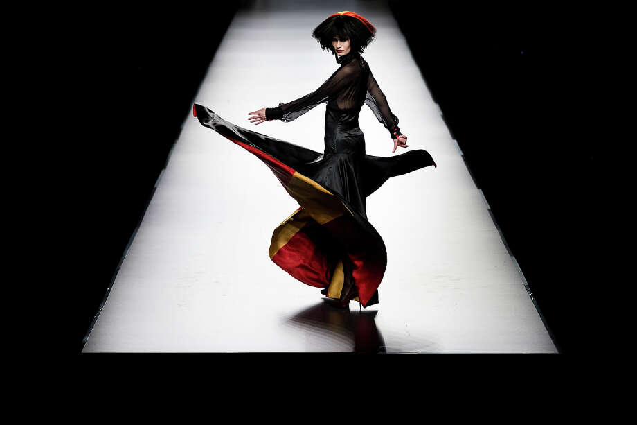 A model displays an Autumn/Winter design by Francis Montesinos during Madrid's Fashion Week, in Madrid, Monday, Feb. 18, 2013. Photo: Daniel Ochoa De Olza, AP / 2013 AP