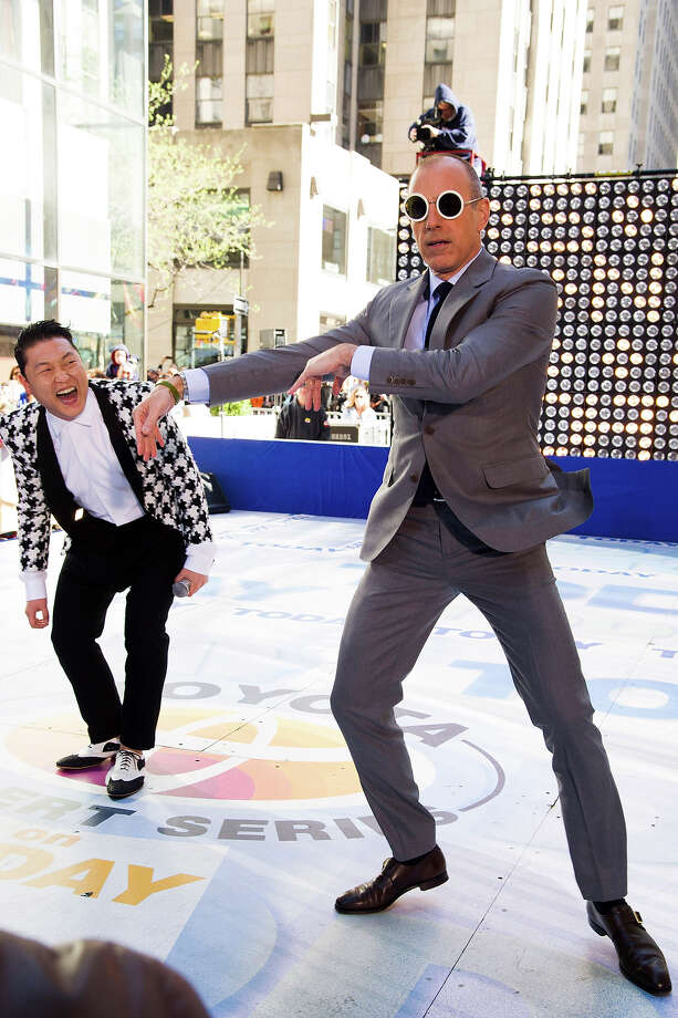 "Psy, left, teaches Matt Lauer his dance moves on NBC's ""Today"" show on Friday, May 3, 2013 in New York. Photo: Charles Sykes, Charles Sykes/Invision/AP / AP2013"