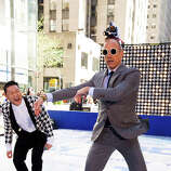 "Psy, left, teaches Matt Lauer his dance moves on NBC's ""Today"" show on Friday, May 3, 2013 in New York."