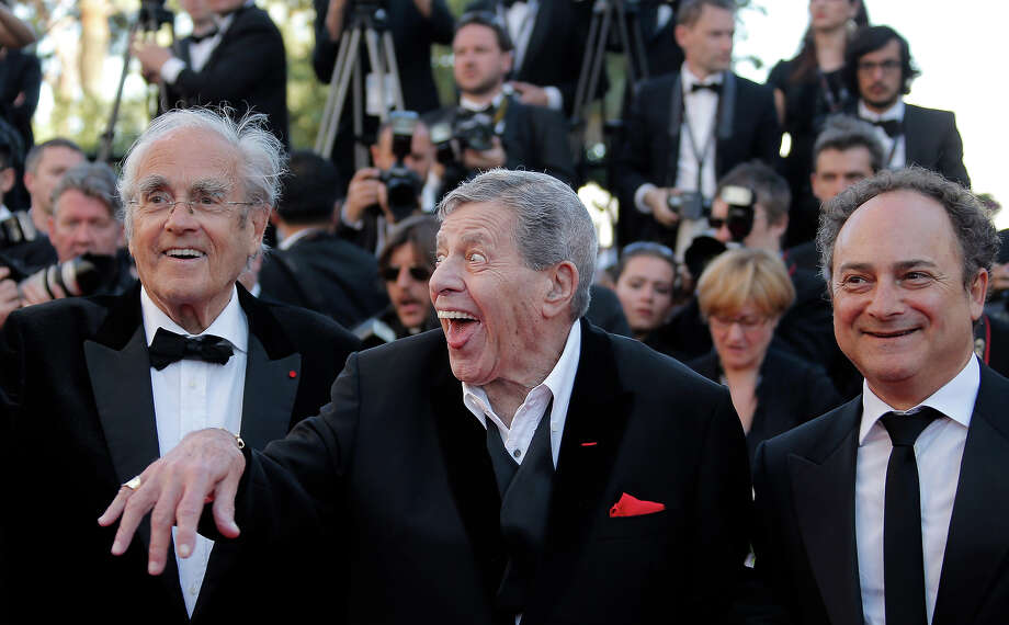 From left, Michel Legrand, comedian Jerry Lewis and actor Kevin Pollak arrive for the screening of Nebraska at the 66th international film festival, in Cannes, southern France, Thursday, May 23, 2013. Photo: Francois Mori, ASSOCIATED PRESS / AP2013