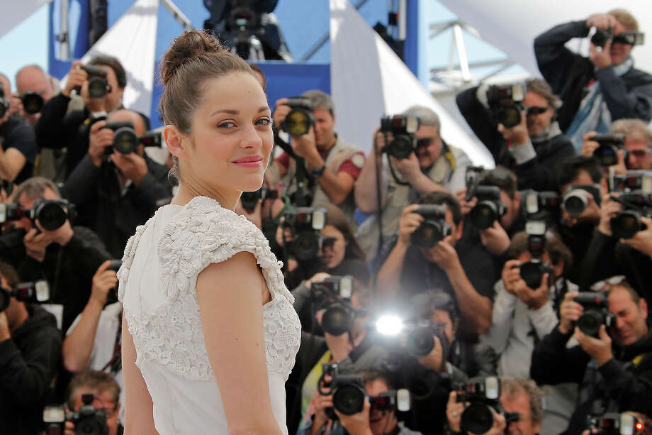 Actress Marion Cotillard poses for photographers during a photo call for the film The Immigrant at the 66th international film festival, in Cannes, southern France, Friday, May 24, 2013. Photo: Francois Mori, ASSOCIATED PRESS / AP2013