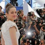 Actress Marion Cotillard poses for photographers during a photo call for the film The Immigrant at the 66th international film festival, in Cannes, southern France, Friday, May 24, 2013.
