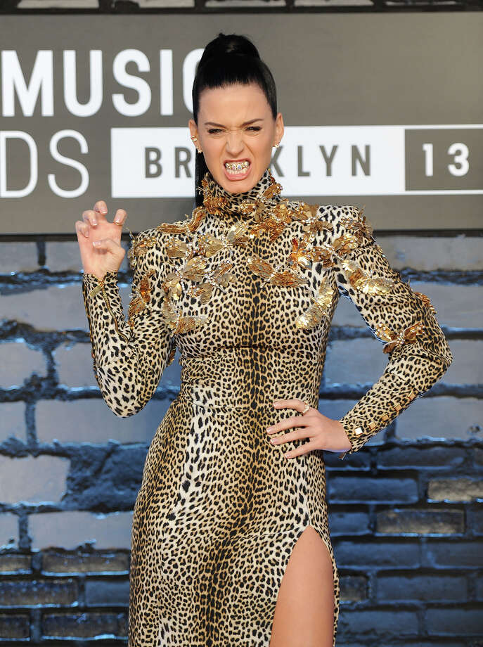 "Katy Perry wears a grill that says ""ROAR"" as she poses at the MTV Video Music Awards on Sunday, Aug. 25, 2013, at the Barclays Center in the Brooklyn borough of New York. Photo: Evan Agostini, Evan Agostini/Invision/AP / AP2013"