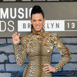 "Katy Perry wears a grill that says ""ROAR"" as she poses at the MTV Video Music Awards on Sunday, Aug. 25, 2013, at the Barclays Center in the Brooklyn borough of New York."